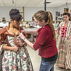 "Assistant professor Bethany Marx helps Nicole Cowans into her costume before Cowans, Katrina Kuharich (right) and other members of the cast of Theatre UAF's production of ""Tartuffe"" performed a live teaser in Wood Center a couple of days before opening night.  <div class=""ss-paypal-button"">Filename: AAR-14-4121-11.jpg</div><div class=""ss-paypal-button-end"" style=""""></div>"