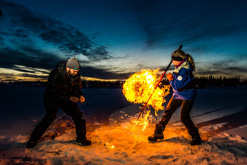 """Research Associate Professor Katey Walter Anthony and a research assistant set fire to escaping methane gas trapped beneath the ice on a pond near the UAF campus. The naturally occurring phenomenon is made worse by thawing permafrost and increased plant decay caused by global warming.  <div class=""""ss-paypal-button"""">Filename: AAR-16-4815-54.jpg</div><div class=""""ss-paypal-button-end""""></div>"""
