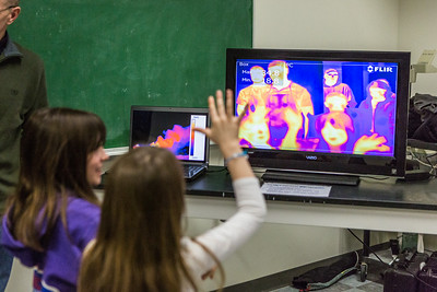 Children interact with thermal sensing cameras during the Science Potpourri at the Reichardt  Building.  Filename: AAR-14-4141-69.jpg