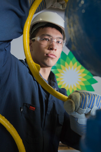 """Stefan Weingarth opens a valve on the oil field well head at CTC's process technology facility on Van Horn Road.  <div class=""""ss-paypal-button"""">Filename: AAR-11-3230-045.jpg</div><div class=""""ss-paypal-button-end"""" style=""""""""></div>"""