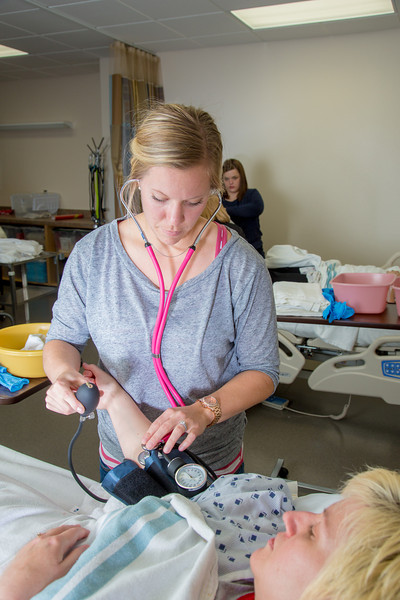 "Sarah Mergen practices taking the blood pressure of fellow student Mollie Egger during an exercise in their nurse aide training program at UAF's Community and Technical College.  <div class=""ss-paypal-button"">Filename: AAR-12-3548-057.jpg</div><div class=""ss-paypal-button-end"" style=""""></div>"