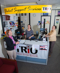 Staff members Sarah Smith, Vernae Angnaboogok, Jen Bergstrom and  greet students at the front counter of UAF's Student Support Services.  Filename: AAR-12-3285-181.jpg