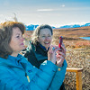 "U.S. Senator Lisa Murkowski snaps some pictures with her iPhone during her brief visit to IAB's Toolik Field Station on Alaska's North Slope in Sept, 2013. Leading Murkowski on her tour was Toolik associate science director Donie Bret-Harte.  <div class=""ss-paypal-button"">Filename: AAR-13-3929-258.jpg</div><div class=""ss-paypal-button-end""></div>"