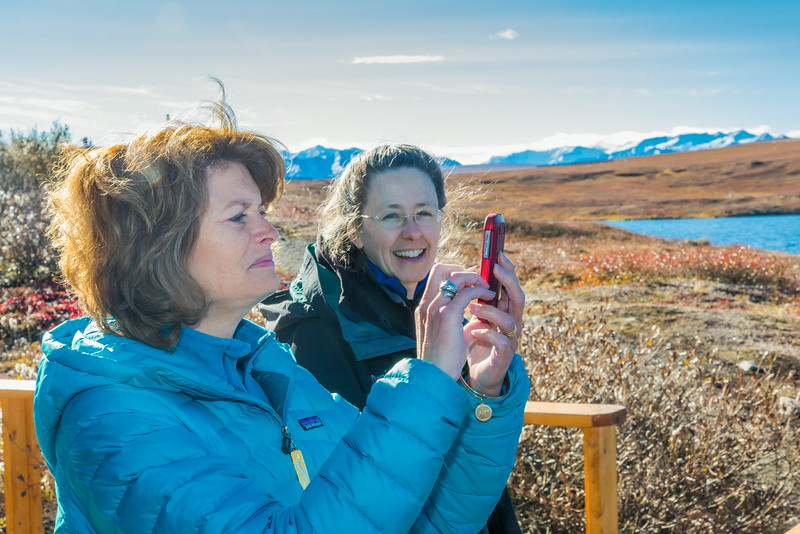 """U.S. Senator Lisa Murkowski snaps some pictures with her iPhone during her brief visit to IAB's Toolik Field Station on Alaska's North Slope in Sept, 2013. Leading Murkowski on her tour was Toolik associate science director Donie Bret-Harte.  <div class=""""ss-paypal-button"""">Filename: AAR-13-3929-258.jpg</div><div class=""""ss-paypal-button-end""""></div>"""