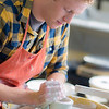 """Art major Ian Wilkinson works on one of approximately 1,000 ceramic bowls needed for his senior thesis project in the fine arts complex on the Fairbanks campus.  <div class=""""ss-paypal-button"""">Filename: AAR-12-3547-049.jpg</div><div class=""""ss-paypal-button-end"""" style=""""""""></div>"""