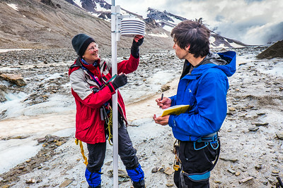 Professor Regine Hock, a glaciologist with UAF's Geophysical Institute, and Tristan Weiss, a research technician with the Institute of Northern Engineering, measure the depth of the ice near the toe of the Jarvis Glacier in the eastern Alaska Range.  Filename: AAR-14-4256-424.jpg