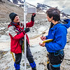 "Professor Regine Hock, a glaciologist with UAF's Geophysical Institute, and Tristan Weiss, a research technician with the Institute of Northern Engineering, measure the depth of the ice near the toe of the Jarvis Glacier in the eastern Alaska Range.  <div class=""ss-paypal-button"">Filename: AAR-14-4256-424.jpg</div><div class=""ss-paypal-button-end""></div>"