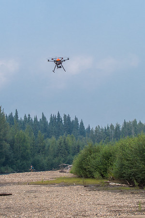 An unmanned aerial vehicle (UAV) stands ready to collect video of important king salmon spawning habitat along a popular stretch of the upper Chena River about 40 miles northeast of Fairbanks. The project was a collaboration between the Alaska Center for Unmanned Aircraft Systems Integration (ACUASI) and the U.S. Fish and Wildlife Service.  Filename: AAR-15-4593-352.jpg