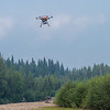 "An unmanned aerial vehicle (UAV) stands ready to collect video of important king salmon spawning habitat along a popular stretch of the upper Chena River about 40 miles northeast of Fairbanks. The project was a collaboration between the Alaska Center for Unmanned Aircraft Systems Integration (ACUASI) and the U.S. Fish and Wildlife Service.  <div class=""ss-paypal-button"">Filename: AAR-15-4593-352.jpg</div><div class=""ss-paypal-button-end""></div>"