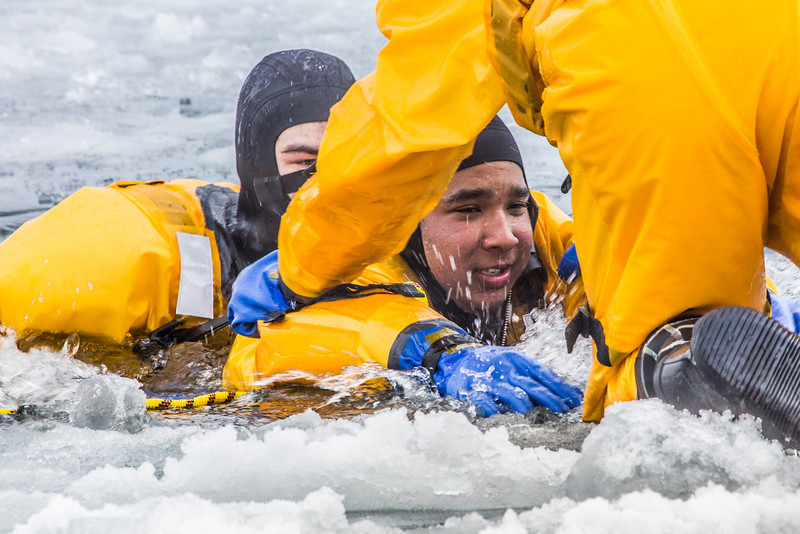 """Student firefighters practice cold-water rescue techniques at a pond near the Fairbanks campus.  <div class=""""ss-paypal-button"""">Filename: AAR-13-3797-60.jpg</div><div class=""""ss-paypal-button-end"""" style=""""""""></div>"""