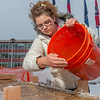 "Civil engineering major Katrina Monta adds water to a mixture combined with sawdust which when frozen, hardens into a substance many times stronger than concrete. Katrina and others are hard at work on this year's traditional ice arch, designed and built each year by engineering students.  <div class=""ss-paypal-button"">Filename: AAR-13-3727-28.jpg</div><div class=""ss-paypal-button-end"" style=""""></div>"