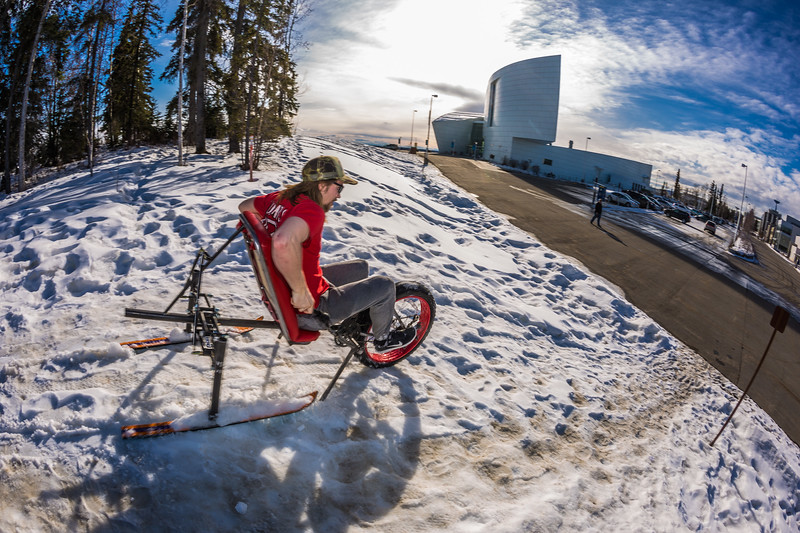 """Mechanical engineering major Eric Bookless demonstrates the fat tire ski bike he and two partners designed and built for paraplegic users as their spring 2016 senior design project. The bike is powered by pushing and pulling on the handles.  <div class=""""ss-paypal-button"""">Filename: AAR-16-4856-80.jpg</div><div class=""""ss-paypal-button-end""""></div>"""