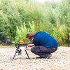 "Trevor Parcell with the Alaska Center for Unmanned Aircraft Systems Integration (ACUASI) adjusts an unmanned aerial vehicle used to collect video of a popular stretch of the upper Chena River which serves as prime king salmon habitat.  <div class=""ss-paypal-button"">Filename: AAR-15-4593-285.jpg</div><div class=""ss-paypal-button-end""></div>"