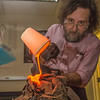 "Geology professor Rainer Newberry pours hot lava over volcanic basalt in a lab in the Reichardt Building on the Fairbanks campus.  <div class=""ss-paypal-button"">Filename: AAR-13-3730-51.jpg</div><div class=""ss-paypal-button-end"" style=""""></div>"