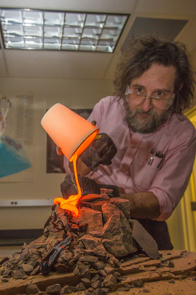 """Geology professor Rainer Newberry pours hot lava over volcanic basalt in a lab in the Reichardt Building on the Fairbanks campus.  <div class=""""ss-paypal-button"""">Filename: AAR-13-3730-51.jpg</div><div class=""""ss-paypal-button-end"""" style=""""""""></div>"""