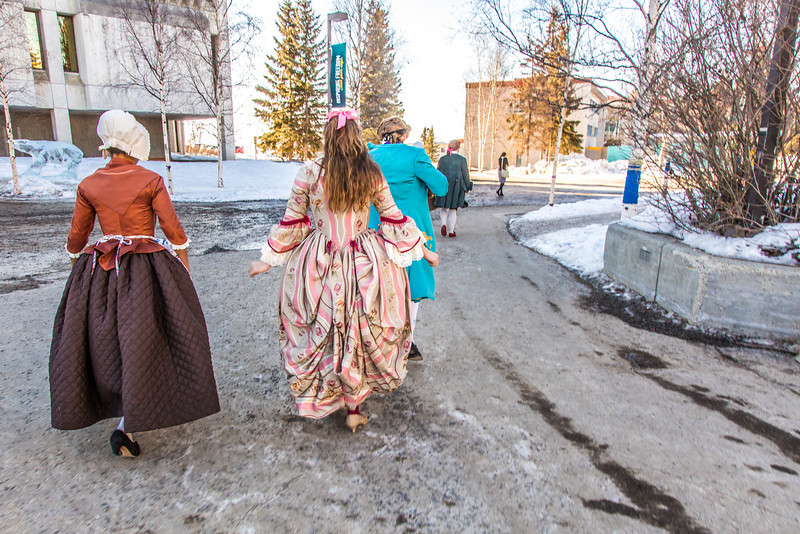 """Cast members of Theatre UAF's production of """"Tartuffe"""" walk across campus before performing a live teaser in Wood Center a couple of days before opening night.  <div class=""""ss-paypal-button"""">Filename: AAR-14-4121-23.jpg</div><div class=""""ss-paypal-button-end"""" style=""""""""></div>"""