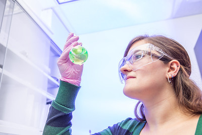 Chemistry major Emily Olson completes a procedure in a Reichardt Building lab.  Filename: AAR-12-3598-171.jpg