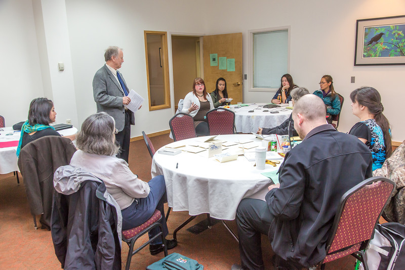 """Associate Professor Mike Davis, standing, with UAF's Alaska Native Studies and Rural Development program, leads a morning discussion with a group of students from rural Alaska in a weeklong seminar on Understanding the Legislative Process in the state capital of Juneau.  <div class=""""ss-paypal-button"""">Filename: AAR-14-4054-3.jpg</div><div class=""""ss-paypal-button-end"""" style=""""""""></div>"""