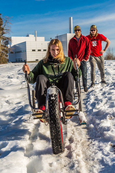 """Mechanical engineering major Daniel Sandstrom operates a fat tire ski bike he and partners Neil Gotschall, left, and Eric Bookless designed and built for paraplegic users as their spring 2016 senior design project. The bike is powered by pushing and pulling on the handles.  <div class=""""ss-paypal-button"""">Filename: AAR-16-4856-60.jpg</div><div class=""""ss-paypal-button-end""""></div>"""