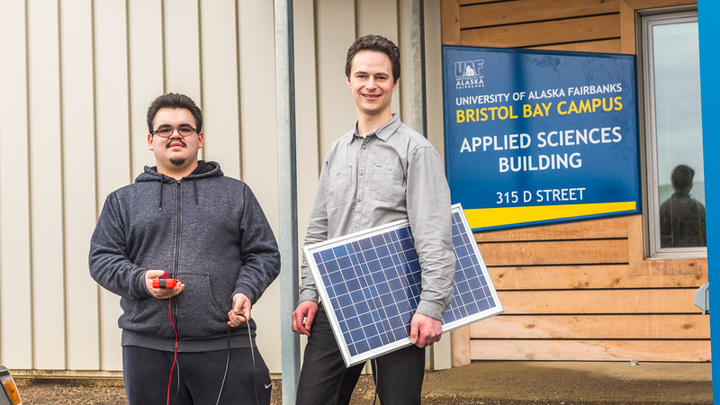 """Assistant Professor Tom Marsik, right, and undergraduate Andrew Akelkok post outside their Applied Sciences Building at UAF's Bristol Bay Campus in Dillingham.  <div class=""""ss-paypal-button"""">Filename: AAR-16-4860-260.jpg</div><div class=""""ss-paypal-button-end""""></div>"""