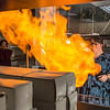 """UAF chemistry professor Cathy Cahill seems to enjoy blowing up balloons filled with hydrogen during a demonstration for her students in a Reichardt Building lab.  <div class=""""ss-paypal-button"""">Filename: AAR-13-4021-5.jpg</div><div class=""""ss-paypal-button-end"""" style=""""""""></div>"""