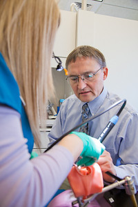 Program director Vaughan Hoefler works with one of his students in CTC's dental hygienist program in their training facility in downtown Fairbanks.  Filename: AAR-12-3308-065.jpg