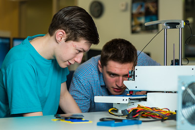 Stephen Ramirez, left, and Daniel Dougherty watch the progress on their project during an open work session in UAF's Community and Technical College's 3-D print lab in downtown Fairbanks.  Filename: AAR-16-4857-017.jpg