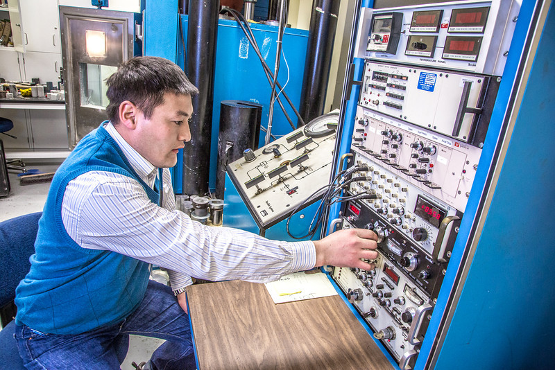 """UAF graduate student Erdenebaatar Dondov works with samples of rare earth minerals in a Duckering Building lab. Narantsetseg is part of a partnership between UAF and the Mongolian government to establish a school of mining engineering there to educate locals to help develop the country's mineral resources.  <div class=""""ss-paypal-button"""">Filename: AAR-13-3842-103.jpg</div><div class=""""ss-paypal-button-end"""" style=""""""""></div>"""