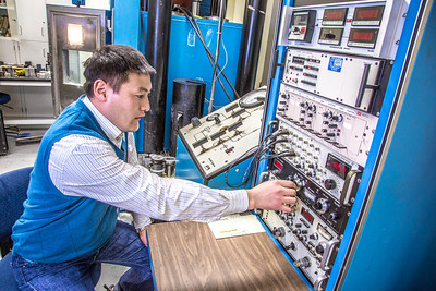 UAF graduate student Erdenebaatar Dondov works with samples of rare earth minerals in a Duckering Building lab. Narantsetseg is part of a partnership between UAF and the Mongolian government to establish a school of mining engineering there to educate locals to help develop the country's mineral resources.  Filename: AAR-13-3842-103.jpg