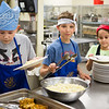 "Students from Summer Sessions' Café Tween pose for a photograph after cooking Italian cuisine at Hutchinson's kitchen.  <div class=""ss-paypal-button"">Filename: AAR-12-3432-4.jpg</div><div class=""ss-paypal-button-end"" style=""""></div>"