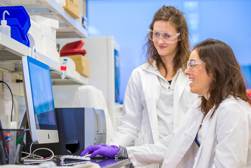 """Undergraduate Alyssa Komac, right, and graduate student Theresia Schnurr study the data they're getting in their research involving the metabolism in Alaska sled dogs.  <div class=""""ss-paypal-button"""">Filename: AAR-12-3673-118.jpg</div><div class=""""ss-paypal-button-end"""" style=""""""""></div>"""