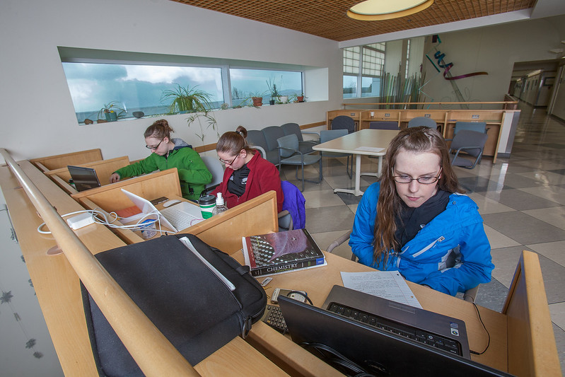 """Undergraduates Danielle Woodard, left, Robin Palmer and Trystin Hodge study between classes in a common area in the Reichardt Building on the Fairbanks campus.  <div class=""""ss-paypal-button"""">Filename: AAR-12-3386-48.jpg</div><div class=""""ss-paypal-button-end"""" style=""""""""></div>"""