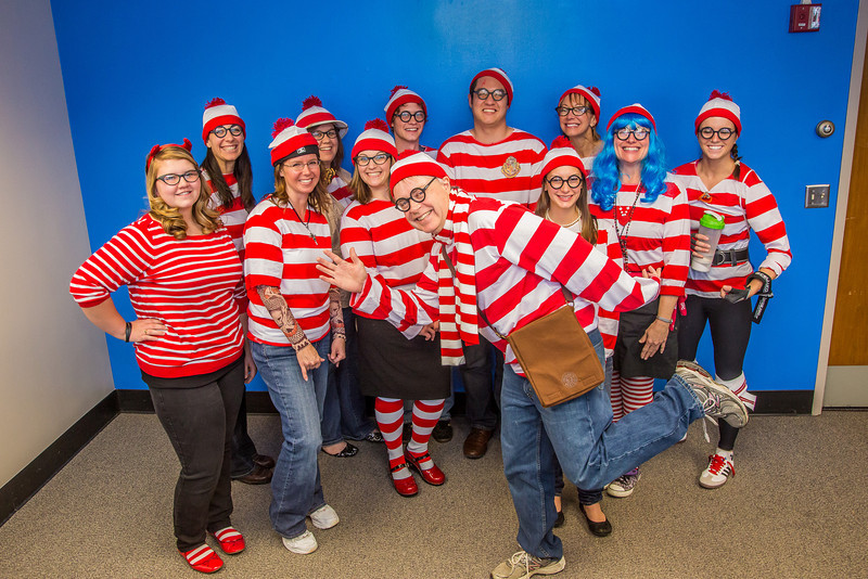 """School of Management Dean Mark Hermann, front and center, joined several members of his administrative staff in a Where's Waldo exercise for a Political Economy class.  <div class=""""ss-paypal-button"""">Filename: AAR-12-3621-69.jpg</div><div class=""""ss-paypal-button-end"""" style=""""""""></div>"""