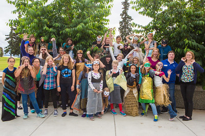 Dressed in their animal costumes, Colors of Nature students with their instructors gather for a group photo after two weeks of learning science and art in front of the Murie Building.  Filename: AAR-16-4938-28.jpg