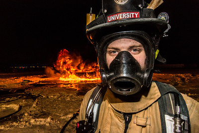 Probationary firefighter Ryan Sims takes part in a live training drill at the Fairbanks International Airport.  Filename: AAR-13-3995-121.jpg