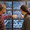 "Computer science faculty members Jon Genetti, left, and Orion Lawlor inspect a high resolution aerial photo of Fairbanks on the bioinformatics powerwall in the Chapman Building.  <div class=""ss-paypal-button"">Filename: AAR-12-3272-148.jpg</div><div class=""ss-paypal-button-end"" style=""""></div>"