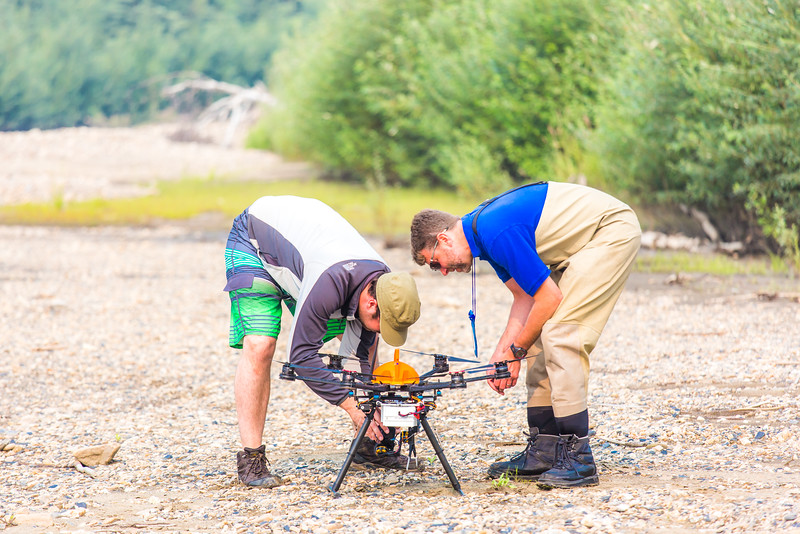"""Carl France, left, with the Alaska Center for Unmanned Aircraft Systems Integration (ACUASI) and Jimmy Fox, deputy field supervisor with the U.S. Fish and Wildlife Service, inspect an unmanned aerial vehicle used to collect video of a popular stretch of the upper Chena River which serves as prime king salmon habitat.  <div class=""""ss-paypal-button"""">Filename: AAR-15-4593-277.jpg</div><div class=""""ss-paypal-button-end""""></div>"""