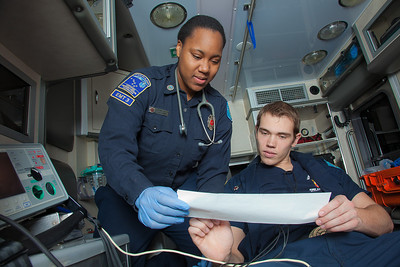 UAF student firefighters/EMTs Lillian Hampton and Cory Kelly practice on each other during a training exercise in the back of an ambulance housed in the Whitaker Building on the Fairbanks campus.  Filename: AAR-11-3223-69.jpg