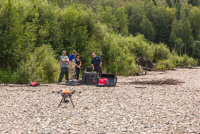 Personnel with the U.S. Fish and Wildlife Service and the Alaska Center for Unmanned Aircraft Systems Integration (ACUASI) establish a piloting station on a gravel bar along a stretch of the upper Chena River in an effort to collect aerial video of prime king salmon spawning habitat.  Filename: AAR-15-4593-194.jpg
