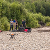 "Personnel with the U.S. Fish and Wildlife Service and the Alaska Center for Unmanned Aircraft Systems Integration (ACUASI) establish a piloting station on a gravel bar along a stretch of the upper Chena River in an effort to collect aerial video of prime king salmon spawning habitat.  <div class=""ss-paypal-button"">Filename: AAR-15-4593-194.jpg</div><div class=""ss-paypal-button-end""></div>"