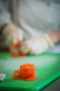 Jenevie Star Burgess prepares a decorative rose blossom from a tomato skin to supplment the lunch menu being served at CTC's culinary arts kitchen in the Hutchison Center.  Filename: AAR-13-3811-246.jpg
