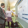 "Paul Layer, dean of UAF's College of Natural Science and Mathematics Dean, listens to a student presentation during UAF's Research Day Poster Session in Wood Center.  <div class=""ss-paypal-button"">Filename: AAR-14-4169-28.jpg</div><div class=""ss-paypal-button-end""></div>"
