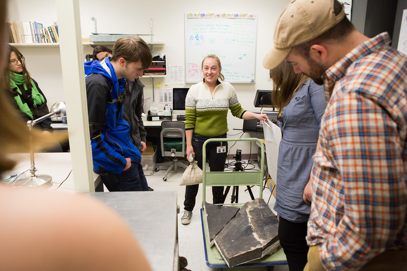 "Collection Specialist Julie Rousseau presents a replica of a fossilized ichthyosaur during to a group of students during a tour of the Museum of the North's lower level during the Life in the Age of Dinosaurs lab.  <div class=""ss-paypal-button"">Filename: AAR-14-4066-48.jpg</div><div class=""ss-paypal-button-end""></div>"