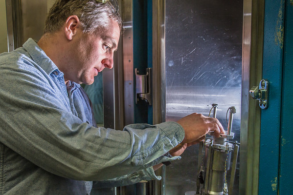 """Research professional Matt Bray prepares concrete samples for testing under extreme pressure in a Duckering Building rock mechanics lab.  <div class=""""ss-paypal-button"""">Filename: AAR-13-3919-90.jpg</div><div class=""""ss-paypal-button-end"""" style=""""""""></div>"""