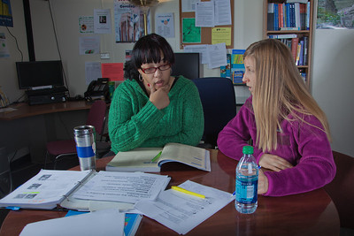 Lauren Divine, right, a tutor with UAF's Student Support Services, works with Sante Lee-Sonkoh during a session in the SSS study lounge in the Gruening Building.  Filename: AAR-12-3285-032.jpg