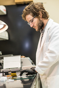 Ph.D. candidate Sean Brennan works in a lab in the Water and Environmental Research Center in the Duckering Building.  Filename: AAR-12-3579-18.jpg
