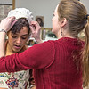 "Assistant professor Bethany Marx helps Nicole Cowans into her costume before Cowans, Katrina Kuharich (right) and other members of the cast of Theatre UAF's production of ""Tartuffe"" performed a live teaser in Wood Center a couple of days before opening night.  <div class=""ss-paypal-button"">Filename: AAR-14-4121-13.jpg</div><div class=""ss-paypal-button-end"" style=""""></div>"
