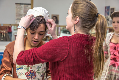 "Assistant professor Bethany Marx helps Nicole Cowans into her costume before Cowans, Katrina Kuharich (right) and other members of the cast of Theatre UAF's production of ""Tartuffe"" performed a live teaser in Wood Center a couple of days before opening night.  Filename: AAR-14-4121-13.jpg"