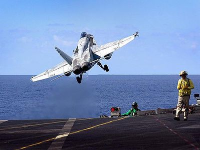 F18 Hornets launch off the deck of the aircraft carrier USS Kittyhawk in the Coral Sea