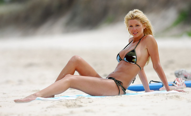 EXCLUSIVE PICTURES - After completing breast surgery and lipsuction on her stomach Hollywood celebrity Tara Reid frolics on a Byron Bay beach during a promotional trip to Australia - PHOTO: CAMERON LAIRD (Ph: +61418238811)